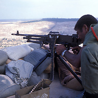 A Fijian soldier, a member of the United Nations Interim Force in Lebanon - UNIFIL troops stationed in southern Lebanon, sets his sites with an M-60 machine gun in Southern Lebanon in 1981.