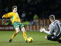 Photo: Chris Ratcliffe.<br />Leicester City v Norwich City. Coca Cola Championship. 31/12/2005.<br />Paul McVeigh (L) of Norwich is only denied a second by Rab Douglas of Leicester.
