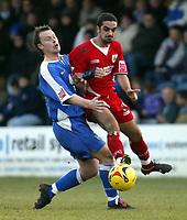 Photo: Chris Ratcliffe.<br />Gillingham v Bristol City. Coca Cola League 1. 26/12/2005.<br />Scott Murray (R) of Bristol City tussles with Michael Flynn of Gillingham.