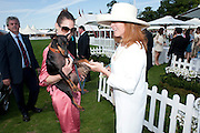 CHARLOTTE SORATO; ROMEO THE DOG, Cartier International Polo. Smiths Lawn. Windsor. 24 July 2011. <br /> <br />  , -DO NOT ARCHIVE-© Copyright Photograph by Dafydd Jones. 248 Clapham Rd. London SW9 0PZ. Tel 0207 820 0771. www.dafjones.com.