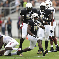 ORLANDO, FL - SEPTEMBER 08:  Titus Davis #10 of the UCF Knights celebrates a tackle during a football game against the South Carolina State Bulldogs at Spectrum Stadium on September 8, 2018 in Orlando, Florida. (Photo by Alex Menendez/Getty Images) *** Local Caption *** Titus Davis