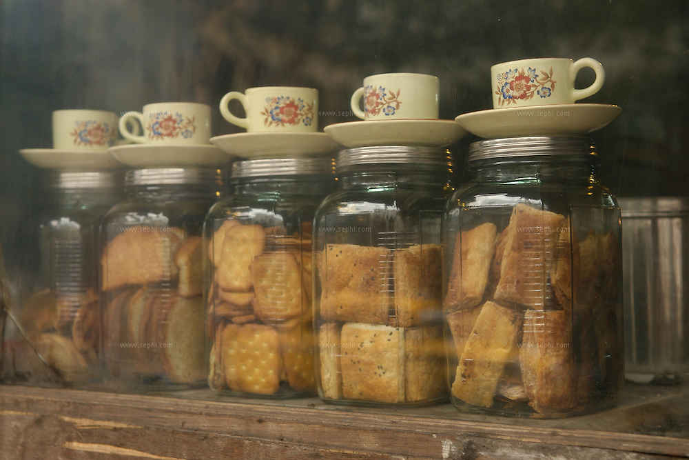 A restaurant window displays the variety of biscuits available for the patrons, Kolkata, January 2007