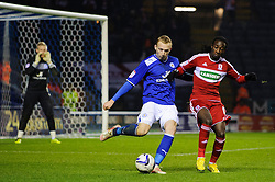 Leicester Defender Ritchie De Laet (BEL) clears under pressure from Middlesbrough Forward Marvin Emnes (NED) during the second half of the match - Photo mandatory by-line: Rogan Thomson/JMP - Tel: Mobile: 07966 386802 18/01/2013 - SPORT - FOOTBALL - King Power Stadium - Leicester. Leicester City v Middlesbrough - npower Championship.