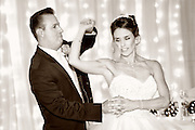 Sepia toned photo of a bride and groom during their first dance at The Genesee Grande Hotel, Syracuse, NY