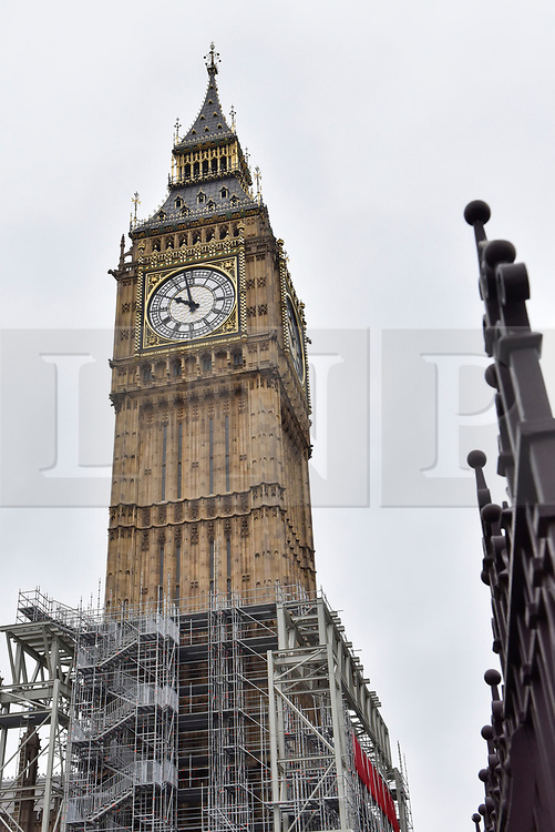 © Licensed to London News Pictures. 21/08/2017. London, UK. London, UK.  21 August 2017.  Big Ben, the bell inside the clock tower known as The Elizabeth Tower, will be silenced ahead of four years of restoration work to the glass on the clock face, the hands of the clock and the tower itself.  One clock face will continue to show the correct time throughout the renovations, driven by a temporary electric motor.  It is planned that the clock will be restarted for Big Ben to chime at New Year, on Remembrance Sunday and other special occasions.  Photo credit : Stephen Chung/LNP