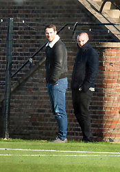 © London News Pictures. 30/11/2012. London, UK. Jamie Redknapp, son of QPR manager Harry Redknapp watches the QPR squad during training at the QPR training ground in Harlington, Wes London. Photo credit: Ben Cawthra/LNP