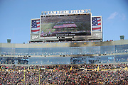 The American flag is shown on the Lambeau Field scoreboard during the playing of the National Anthem before the Green Bay Packers 2017 NFL week 11 regular season football game against the against the Baltimore Ravens, Sunday, Nov. 19, 2017 in Green Bay, Wis. The Ravens won the game in a 23-0 shutout. (©Paul Anthony Spinelli)