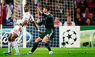 Real Madrid's  Sergio Ramos vies with Ajax Amsterdam's  Ryan Babel during the UEFA Champions League Group D football match Ajax Amsterdam vs Real Madrid on October 3, 2012 AFP PHOTO/ ROBIN UTRECHT.