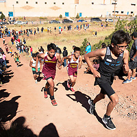 """Varsity boys make their way up """"Heartbreak Hill"""" during the  5000 meter course Saturday morning at the Heartbreak Classic cross country meet in Navajo."""