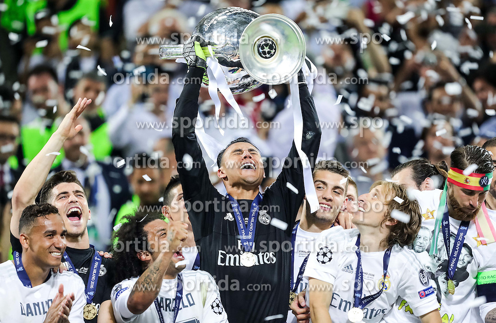 Keylor Navas of Real Madrid and other players celebrate with a Trophy during Trophy ceremony after winning during the football match between Real Madrid (ESP) and Atlético de Madrid (ESP) in Final of UEFA Champions League 2016, on May 28, 2016 in San Siro Stadium, Milan, Italy. Photo by Vid Ponikvar / Sportida
