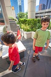 United States, Washington, Bellevue, boys and public art at The Bravern shopping area.  MR