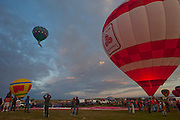 State Farm Insurance Balloon. Albuquerque Balloon Fiesta, New Mexico. Mass assencion on Sunday morning at dawn of 500 hot air balloons.