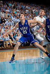 CHAPEL HILL, NC - MARCH 05: Miles Plumlee #21 of the Duke Blue Devils boxes out Tyler Zeller #44 of the North Carolina Tar Heels on March 05, 2011 at the Dean E. Smith Center in Chapel Hill, North Carolina. North Carolina won 67-81. (Photo by Peyton Williams/UNC/Getty Images) *** Local Caption *** Miles Plumlee;Tyler Zeller
