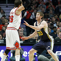 10 March 2012: Utah Jazz shooting guard Gordon Hayward (20) defends on Chicago Bulls shooting guard Kyle Korver (26) during the Chicago Bulls 111-97 victory over the Utah Jazz at the United Center, Chicago, Illinois, USA.