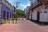 Santa Marta, Colombia -- April 22, 2018. Flower pots block off a side street from regular traffic on  a colorful side street in Santa Marta, Colombia. Editorial use only.