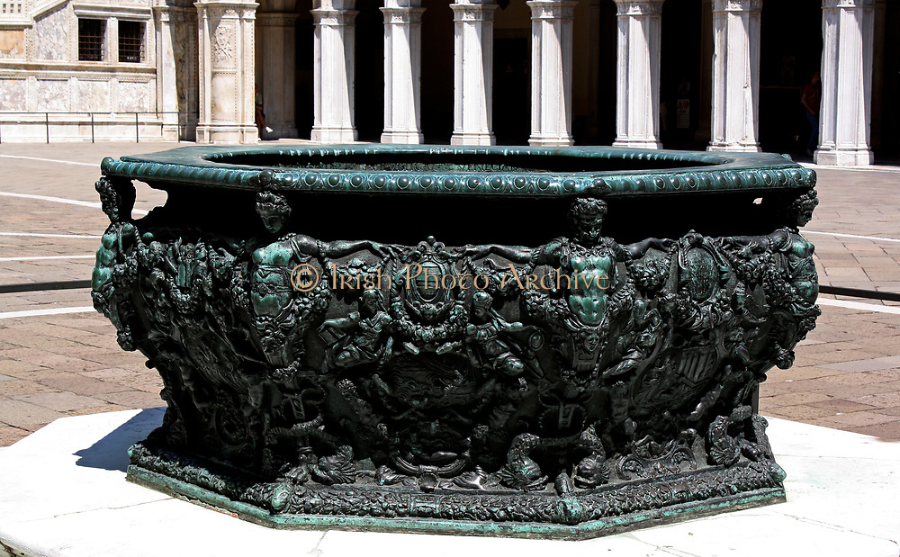 Fountain in the Doge's Palace Courtyard, Venice. Built in Venetian Gothic style the palace was the residence of the Doge of Venice (the supreme authority of the rublic of Venice). It is now open as a museum.