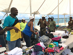 Howard Rickey Mackey, member of parliament for North Eleuthera and one of the organizers, said locals and ex-pats who own homes on the Eleuthera and nearby Harbour Island and Spanish Wells feel fortunate to be able to help the evacuees. Photo by Jacqueline Charles/Miami Herald/TNS/ABACAPRESS.COM
