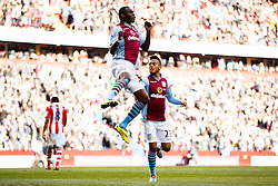 Aston Villa Forward Christian Benteke (BEL) leaps in the compete in the air as he celebrates scoring a goal - Photo mandatory by-line: Rogan Thomson/JMP - 07966 386802 - 23/03/2014 - SPORT - FOOTBALL - Villa Park, Birmingham - Aston Villa v Stoke City - Barclays Premier League.