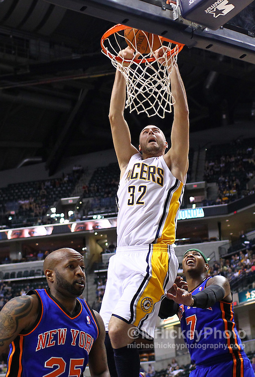 April 10, 2011; Indianapolis, IN, USA; Indiana Pacers forward Josh McRoberts (32) dunks the ball against the New York Knicks at Conseco Fieldhouse. Mandatory credit: Michael Hickey-US PRESSWIRE
