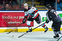 KELOWNA, BC - JANUARY 4: Tristen Nielsen #8 of the Vancouver Giants checks Conner McDonald #7 of the Kelowna Rockets as he looks for the pass during first period at Prospera Place on January 4, 2020 in Kelowna, Canada. (Photo by Marissa Baecker/Shoot the Breeze)