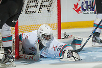 KELOWNA, CANADA - JANUARY 30: Michael Herringer #30 of Kelowna Rockets covers the puck and makes a save against the Victoria Royals on January 30, 2016 at Prospera Place in Kelowna, British Columbia, Canada.  (Photo by Marissa Baecker/Shoot the Breeze)  *** Local Caption *** Michael Herringer;