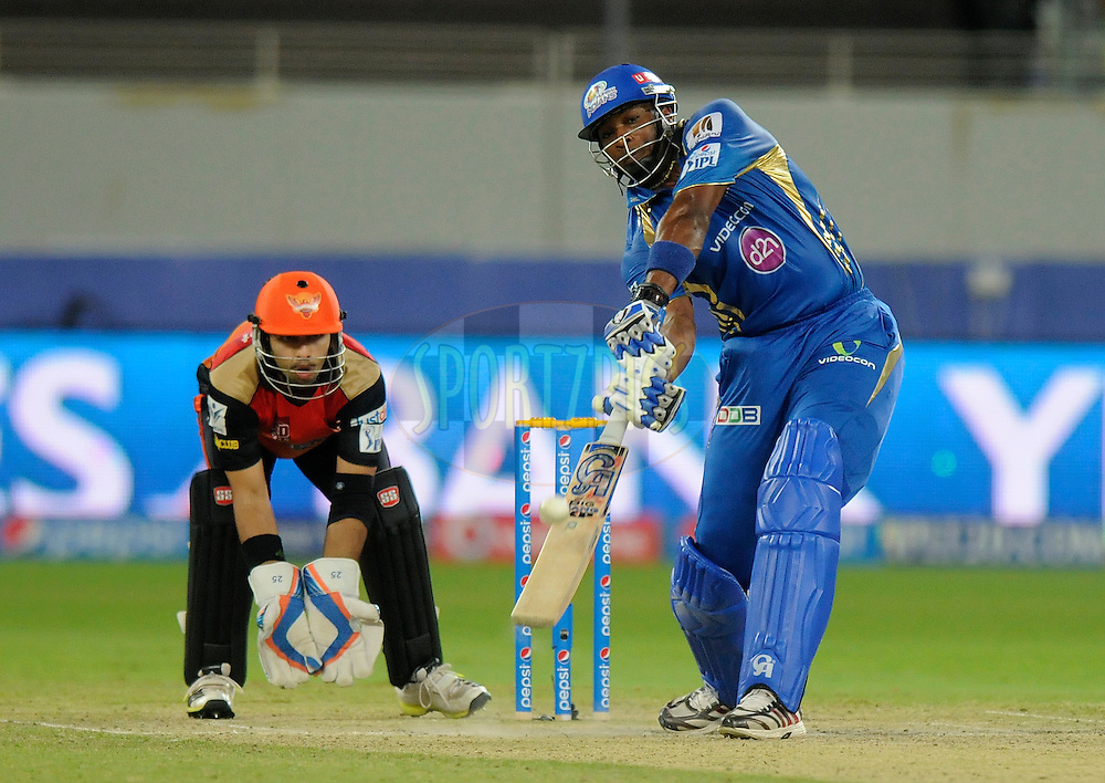 Kieron Pollard of the Mumbai Indians bats during match 20 of the Pepsi Indian Premier League Season 2014 between the Mumbai Indians and the Sunrisers Hyderabad held at the Dubai International Stadium, Dubai, United Arab Emirates on the 30th April 2014<br /> <br /> Photo by Pal Pillia / IPL / SPORTZPICS