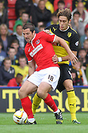 Picture by David Horn/Focus Images Ltd +44 7545 970036<br /> 14/09/2013<br /> Gabriele Angella of Watford (right) holds off Yann Kermorgant of Charlton Athletic (left) during the Sky Bet Championship match at Vicarage Road, Watford.