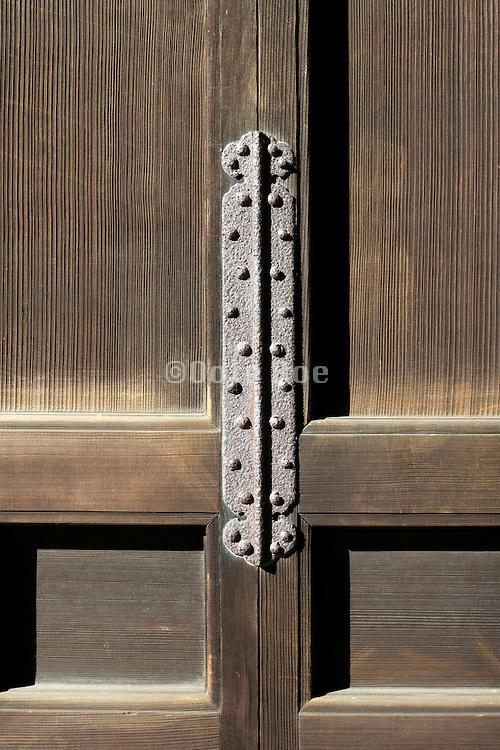 old rusty door hinge at a temple in Kamakura Japan