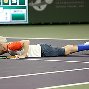 March 1, 2014, Indian Wells, California: <br /> John McEnroe reacts after losing a point during the McEnroe Challenge for Charity presented by Esurance. <br /> (Photo by Billie Weiss/BNP Paribas Open)