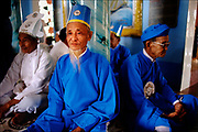 Elders of the Cao Đ&agrave;i faith, a syncretistic, monotheistic religion established in the Vietnamese city of T&acirc;y Ninh, meditate inside their grand temple.  <br />