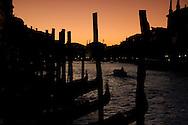 Gondolas along the Grand Canal at dusk;  Venice, Italy