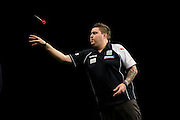 Michael Smith during the Premier League Darts  at the Motorpoint Arena, Cardiff, Wales on 31 March 2016. Photo by Shane Healey.
