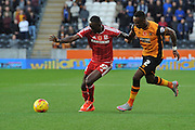 Albert Adomah of Middlesbrough FC and Hull City midfielder Moses Odubajo during the Sky Bet Championship match between Hull City and Middlesbrough at the KC Stadium, Kingston upon Hull, England on 7 November 2015. Photo by Ian Lyall.
