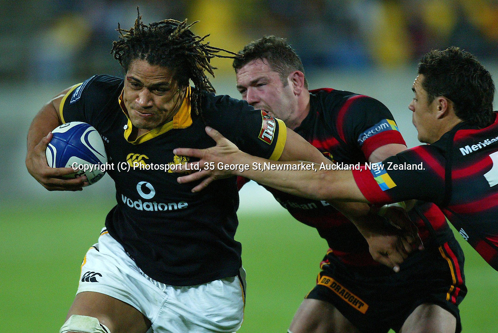 Wellington's captain Rodney So'oialo gets tackled by Canterbury's Reuben Thorne and Daniel Carter during the NPC Div 1 Final, Saturday 24 October 2004,Westpac Stadium, Wellington, New Zealand. Canterbury defeated Wellington 40-27.<br />PHOTO: Marty Melville<br />Photosport
