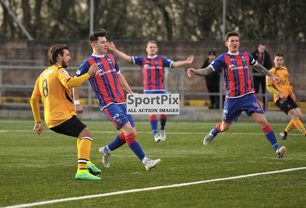 Matty Flynn  (Annan Athletic, amber &amp; black) scores the second goal as Elgin defenders claim offside<br /> <br /> Annan Athletic v Elgin City, SPFL League 2, 30th January 2016<br /> <br /> (c) Alex Todd   SportPix.org.uk