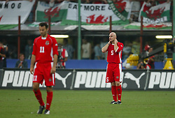 MILAN, ITALY - Saturday, September 6, 2003: Wales' Robert Page dejected after losing 4-0 to Italy during the Euro 2004 qualifying match at the San Siro Stadium. (Pic by David Rawcliffe/Propaganda)