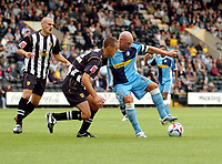 Photo: Leigh Quinnell.<br /> Notts County v Wycombe Wanderers. Coca Cola League 2. 12/08/2006. Wycombe captain Tommy Mooney can't find a way past Notts Countys Dan Gleeson.