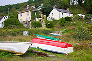 Fishing boats and  village houses at Porthoustock, Cornwall, England