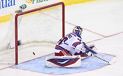 Mar 6; Newark, NJ, USA; New Jersey Devils right wing David Clarkson (23) scores a goal on New York Rangers goalie Henrik Lundqvist (30) during the third period at the Prudential Center. The Devils defeated the Rangers 4-1.