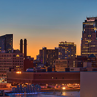 Scenic Boston skyline photography featuring landmarks such as the Gillette World Shaving Headquarters and Boston State Street Corporation photographed on a magnificent sunset night. <br />