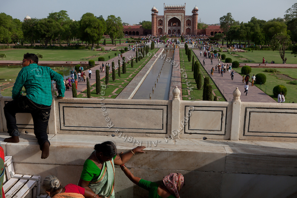 Visitors are making their way up to the stairs leading to the Taj Mahal building, in Agra.