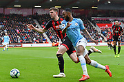 Chris Mepham (33) of AFC Bournemouth battles for possession with Raheem Sterling (7) of Manchester City during the Premier League match between Bournemouth and Manchester City at the Vitality Stadium, Bournemouth, England on 2 March 2019.