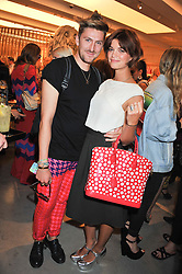 HENRY HOLLAND and PIXIE GELDOF at a party to celebrate the launch of the Vogue Fashion's Night Out held at Mulberry, Bond Street, London on 6th September 2012.