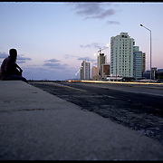 Relaxing along the Malecon. Havana, Cuba.