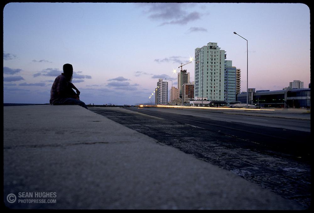 Relaxing along the Malecon. Havana, Cuba.