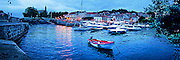 Photographic art panorama of fishing boats at evening in the harbor of Mundaka, Spain