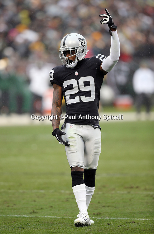 Oakland Raiders cornerback David Amerson (29) raises his arm as he fires up the fans during the 2015 week 15 regular season NFL football game against the Green Bay Packers on Sunday, Dec. 20, 2015 in Oakland, Calif. The Packers won the game 30-20. (©Paul Anthony Spinelli)
