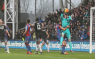 Thibaut Courtois of Chelsea catches a cross under pressure from Mile Jedinak of Crystal Palace during the Barclays Premier League match between Crystal Palace and Chelsea at Selhurst Park, London, England on 3 January 2016. Photo by Ken Sparks.