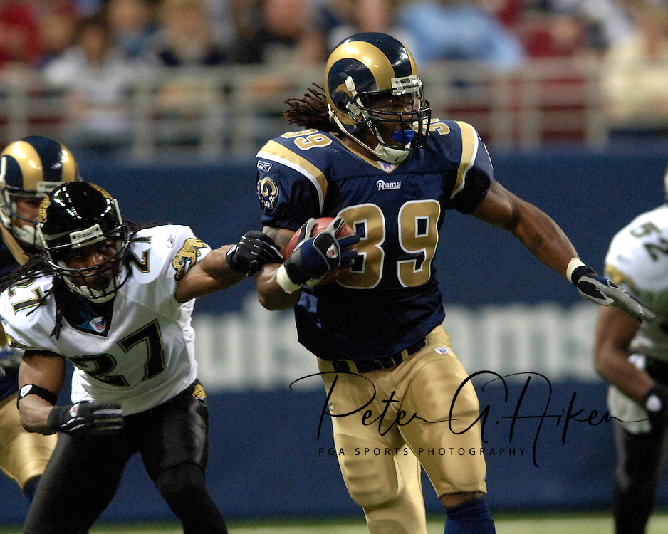 St. Louis Rams running back Steven Jackson (39) rushes past Jacksonville defensive back Rashean Mathis (27) for a first down in the third quarter at the Edward Jones Dome in St. Louis, Missouri, October 30, 2005.  The Rams beat the Jaguars 24-21.