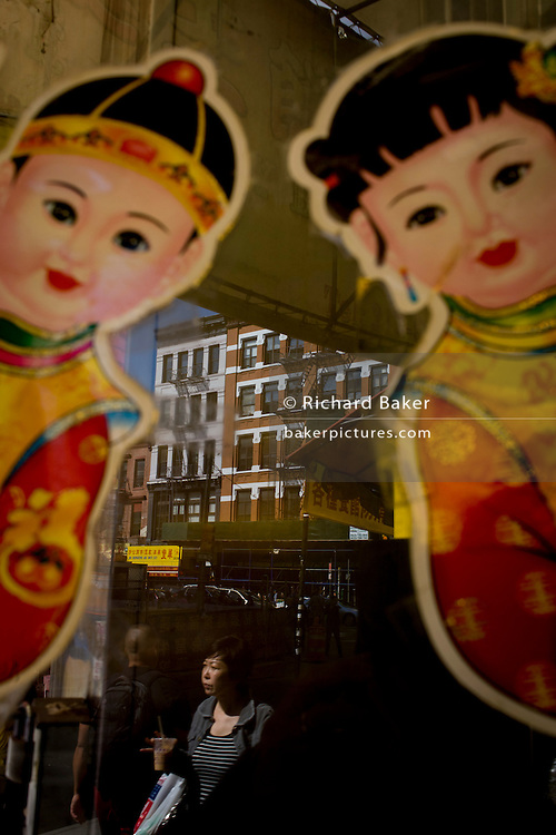 Traditionally-dressed children and modern Chinatown in Manhattan, New York City.